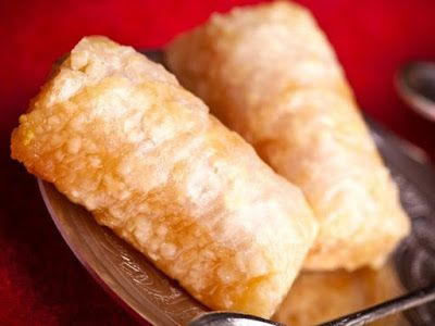 """""""Znoud El Sett"""" Crunchy Phyllo with Cream Dessert. Those are phyllo rolls that are filled with ashta cream then fried and sweetened with sugar syrup. They are best eaten right out of the fryer when they are still crunchy and delicious!"""