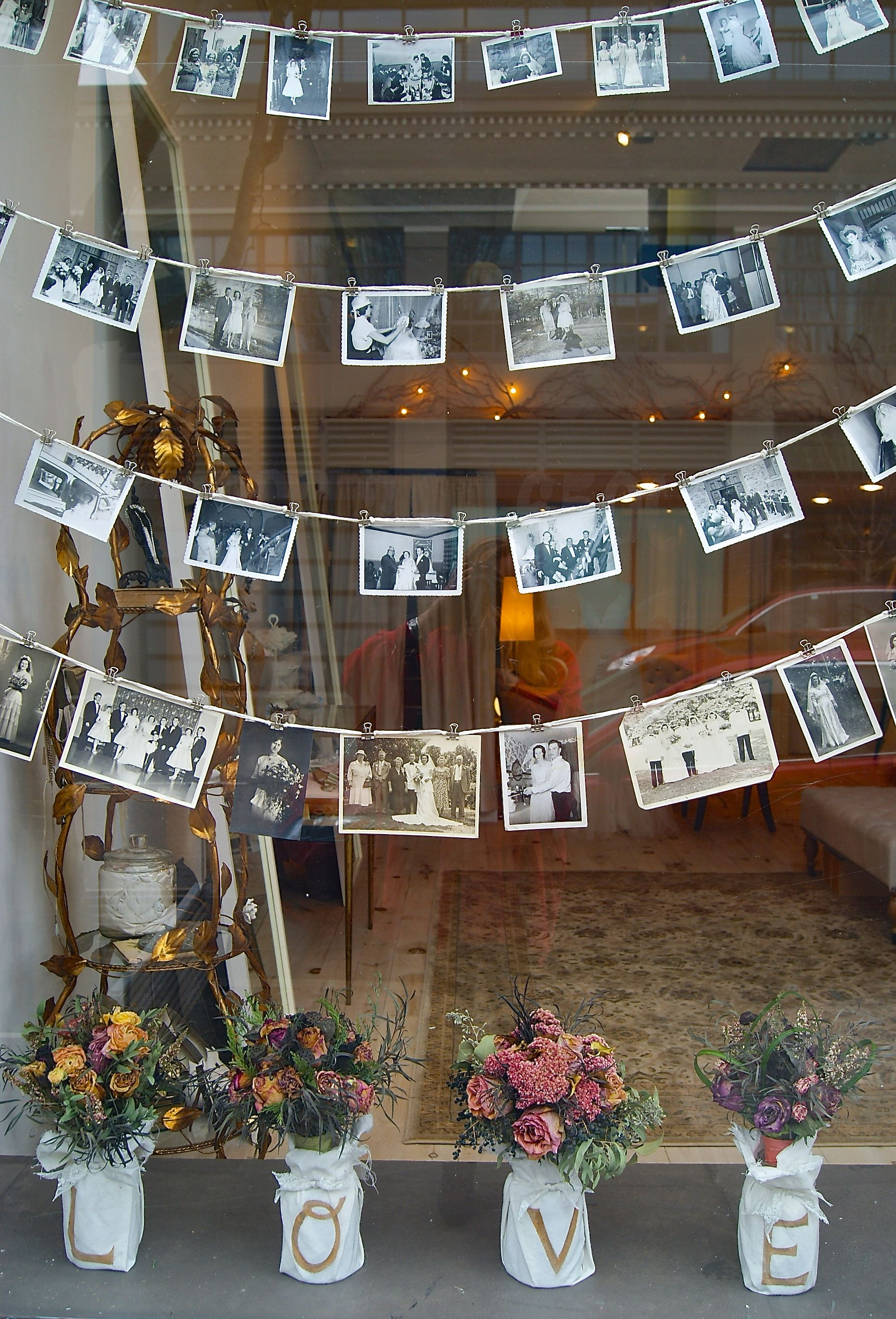 Shop window display…vintage wedding portraits.