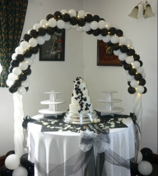 Lighted balloon arch in black and white. Matches the wedding cake to ...