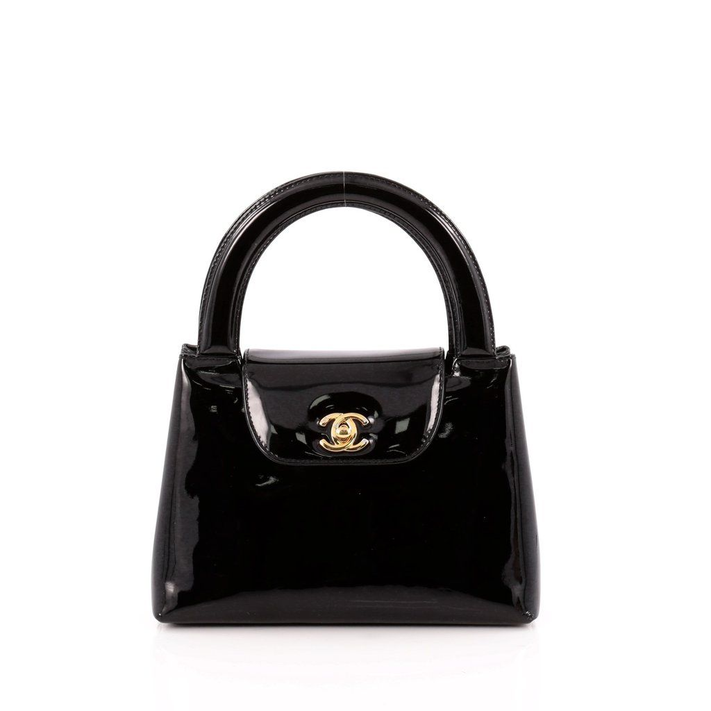 92cf63927c3a Online Sale - Authentic Black Chanel Vintage Top Handle Flap Bag Patent  Small at Trendlee.com. Guaranteed genuine! Financing available. 1331302