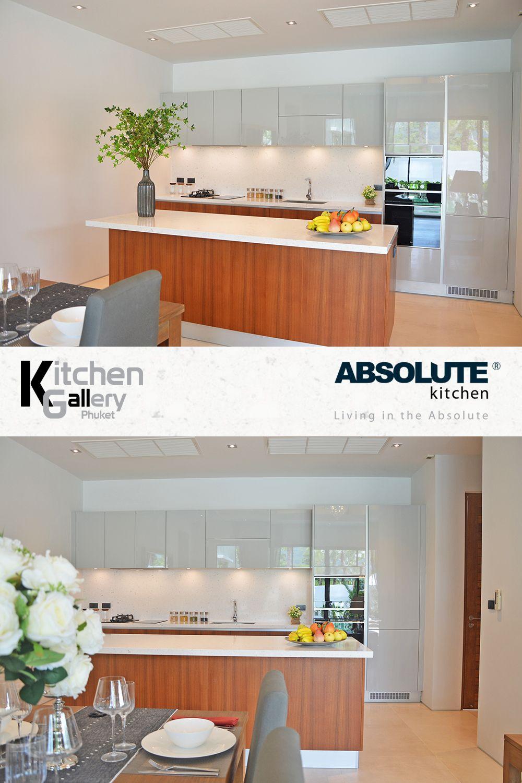 Modern Kitchen with Veneer Teak cabinets and Hi-Gloss Quarzo