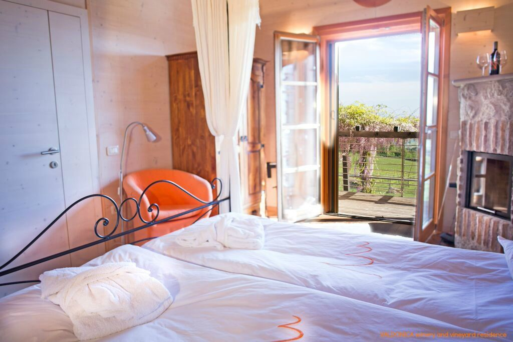 Sweet and #scented room in VALDONICA , which exudes a pleasant and relaxing #sensation through the soft light of the #morning and the view of the #wisteria pergola .