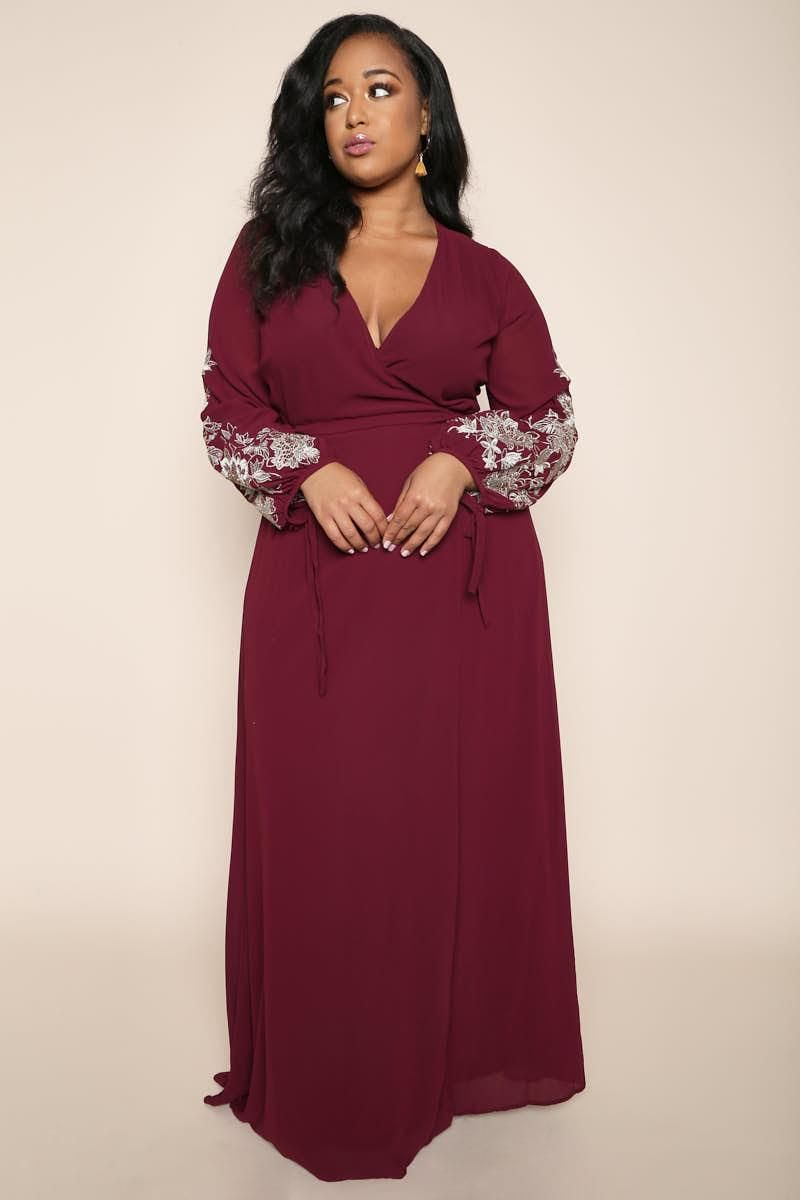 A stunning plus size evening dress featuring long sheer sleeves