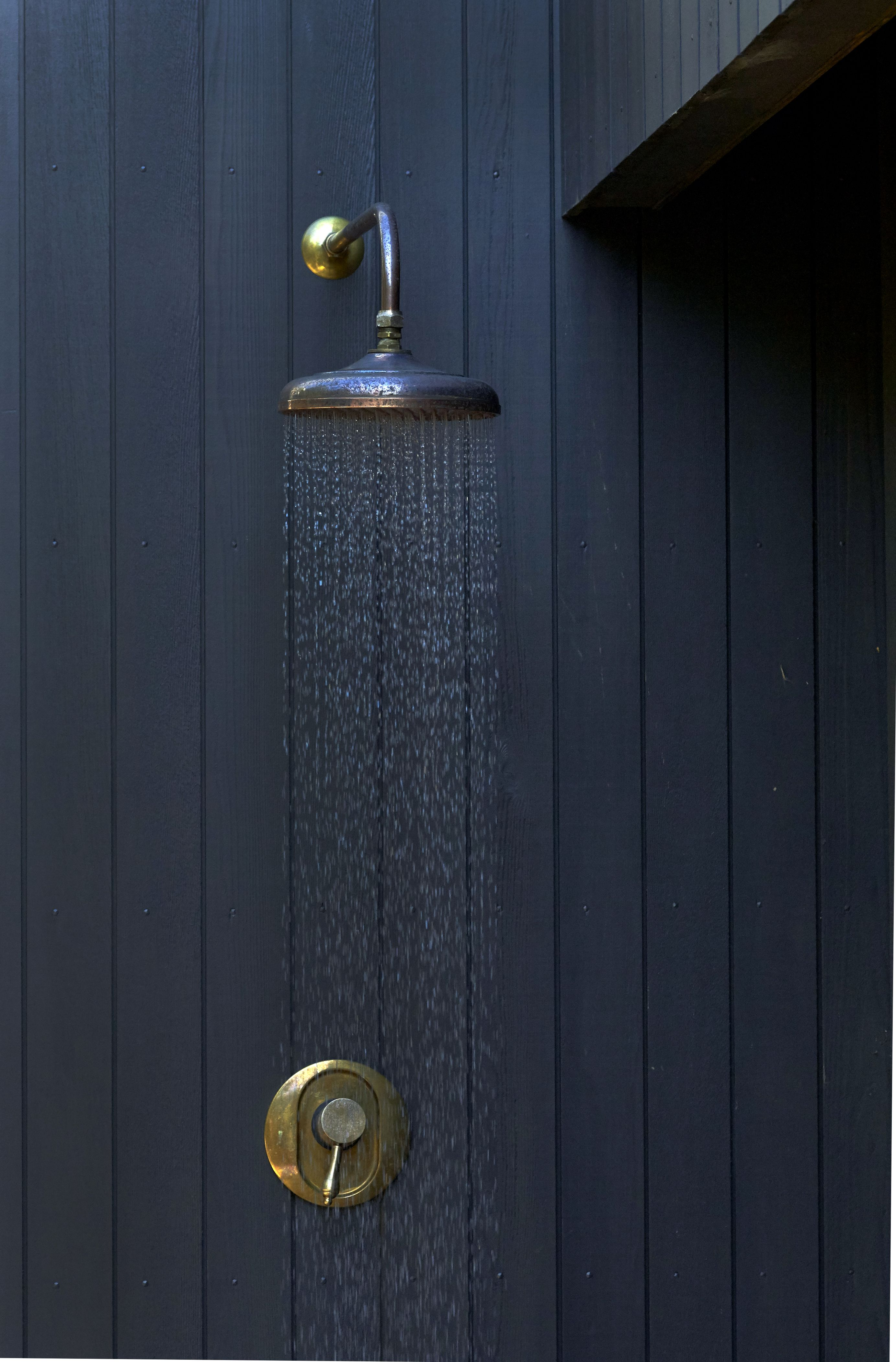 Black cedar cladding with beautiful antique brass finish outdoor ...