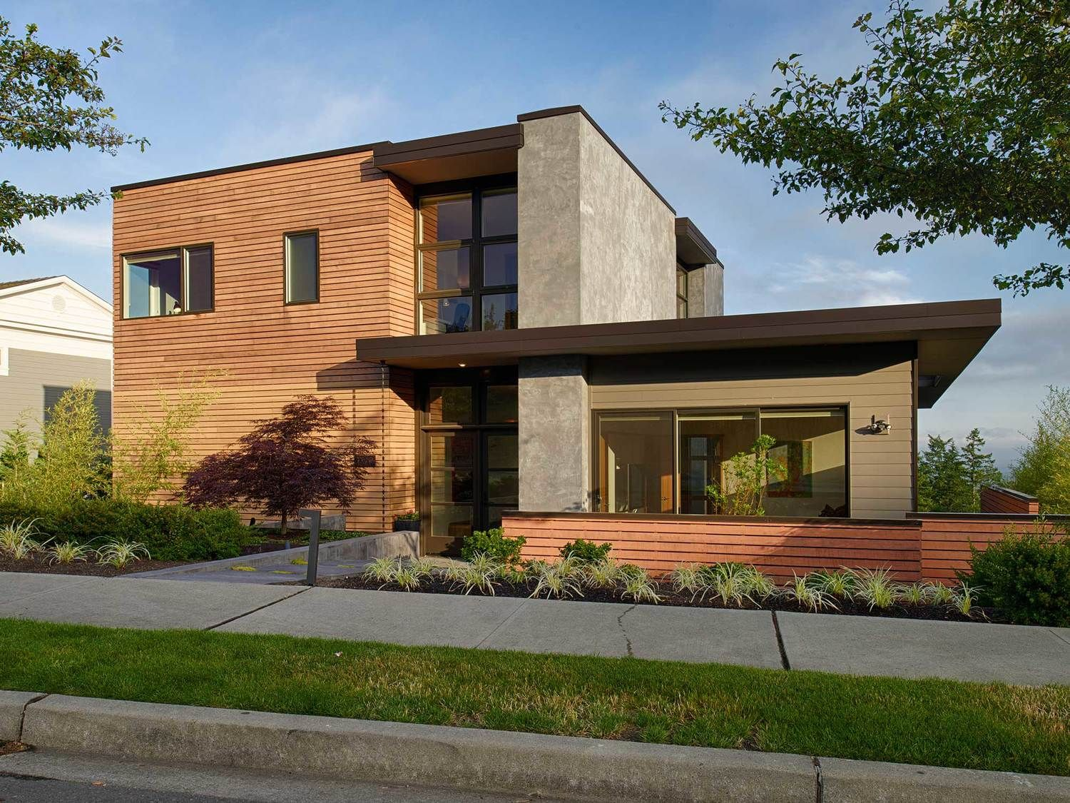 Clap + cedar + grey stucco/concrete