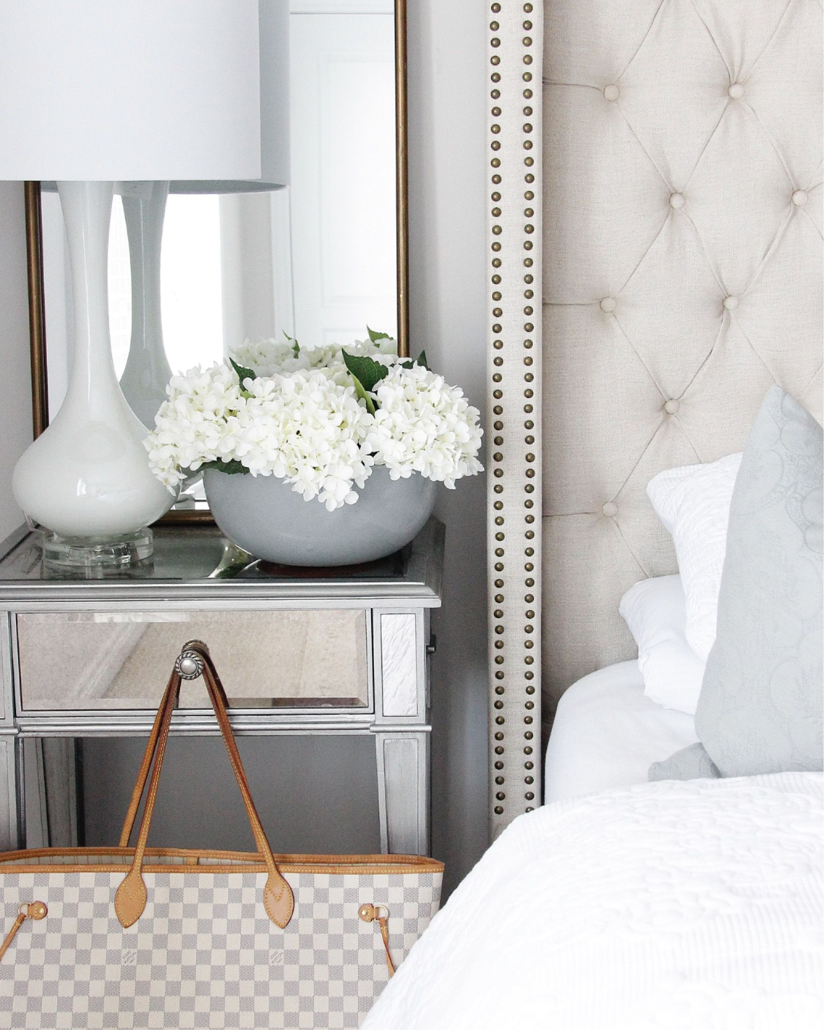Tap photo to shop the look or follow along on Instagram: @p.arruda #Bedroom #MirroredNightstand #TuftedBed #NeutralBedroom #WhiteHome
