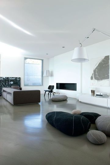 A minimalist living room with big decorative stones Living rooms