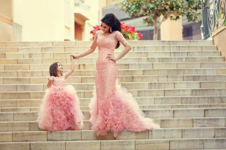 Mummy and daughter in an elegant evening dresses