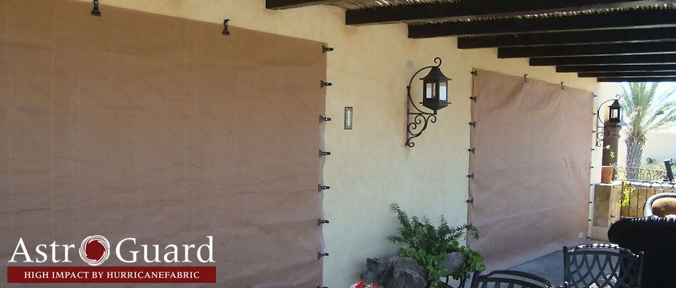 Hurricane Fabric Seems Better Than Plywood And Easier To Handle And Store Hurricane Shutters Hurricane Protection Hurricane Window Protection