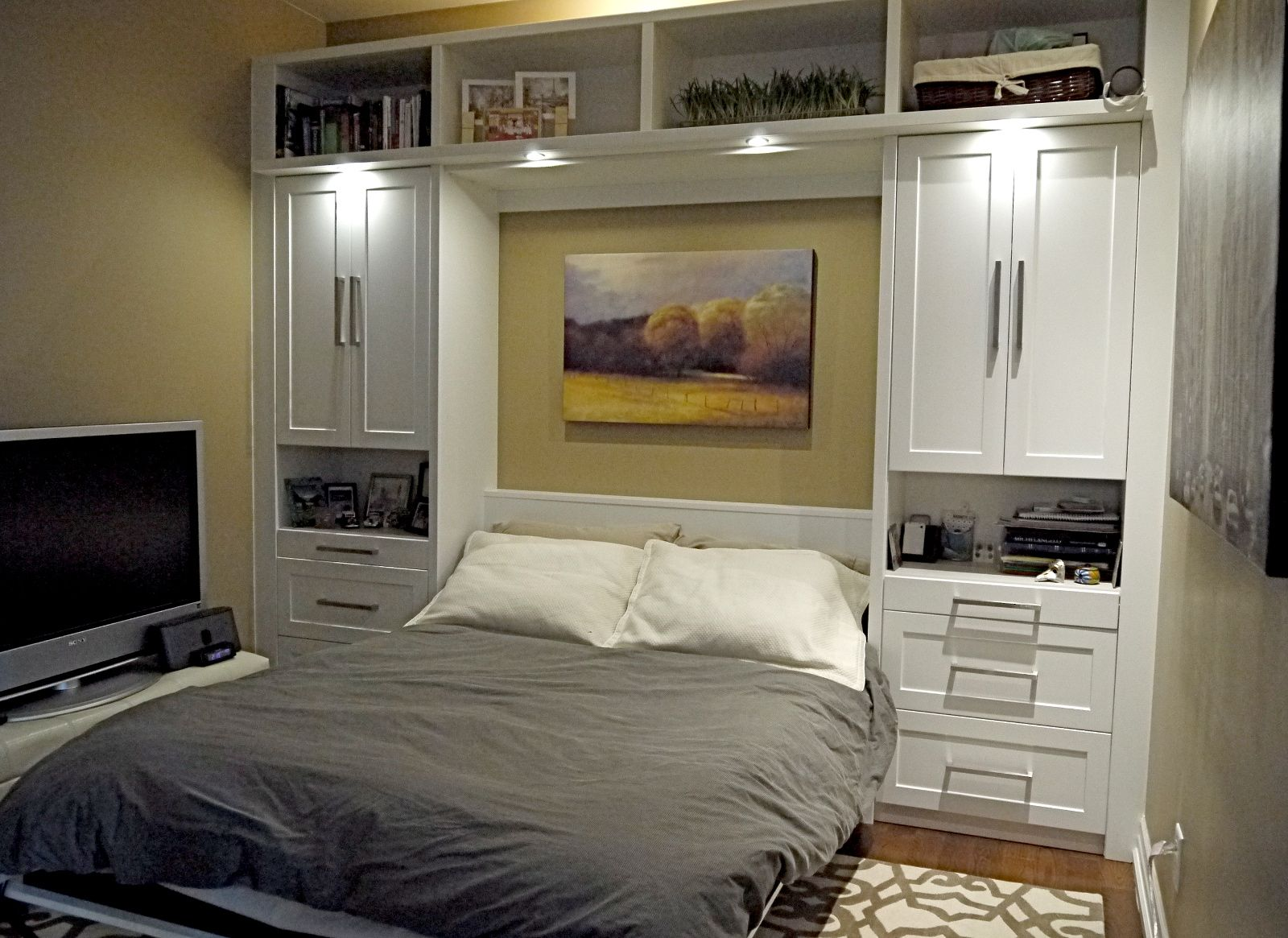 elegance modern murphy bed with grey quilt and white tv table also beauty pattern carpet applyed