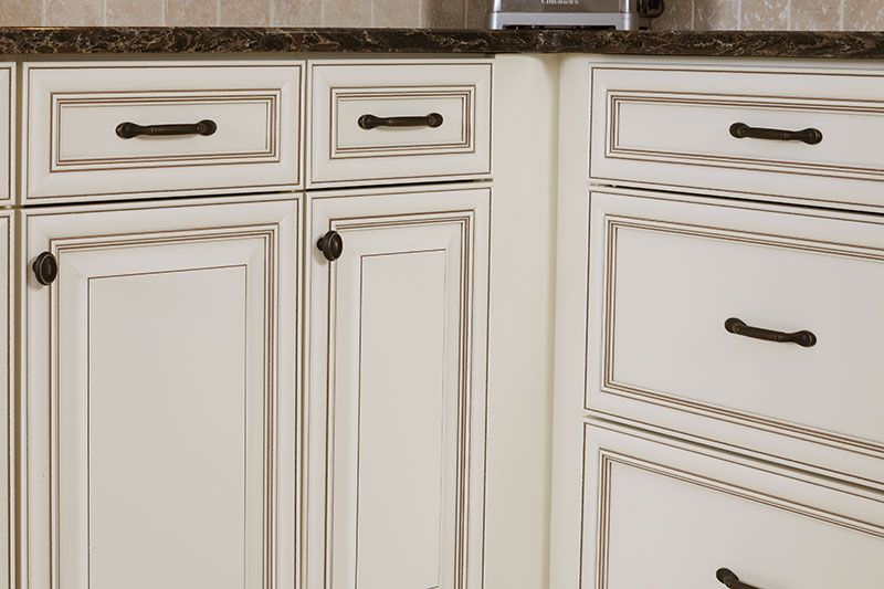 Glazed Cabinets Add Traditional Depth & Dimension to Any Kitchen - Glazed kitchen cabinets, Antique white kitchen cabinets, Antique white kitchen, Refacing kitchen cabinets, White glazed cabinets, Kitchen remodel - Cabinet glaze is a great way to add vintage charm to your kitchen  Here we'll detail different applications of glaze that you can choose from for your cabinets