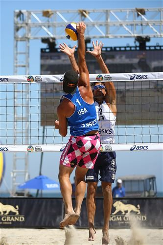 Todd Rogers Of Usa Spikes The Ball Over Paolo Ficosecco Of Italy Beach Volleyball Volleyball Photos Volleyball Pictures