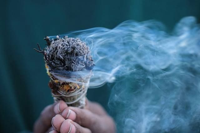 Smudging to cleanse your space and to remove negative energies and sickness