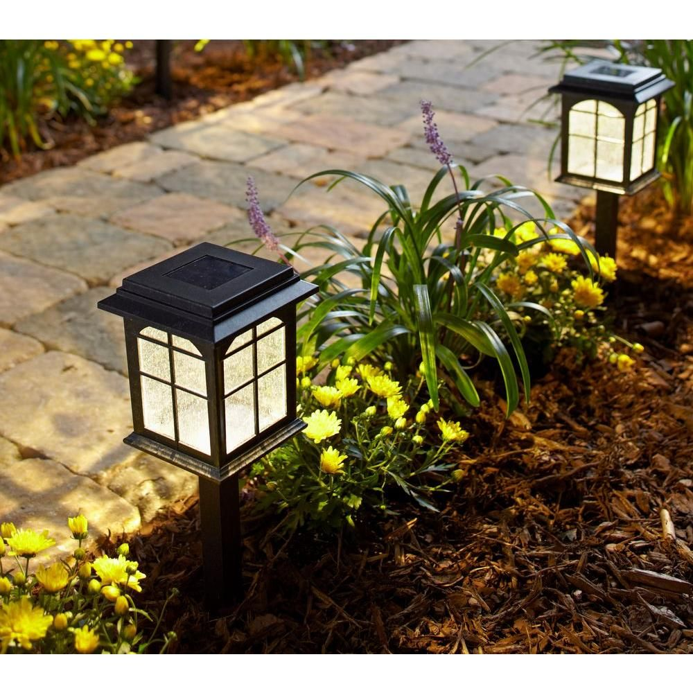 Hampton Bay Solar Black Outdoor Integrated Led Square Landscape Path Light With Seeded Glass Lens 4 Pack Nxt 4400 The Home Depot Solar Pathway Lights Path Lights Solar Path Lights