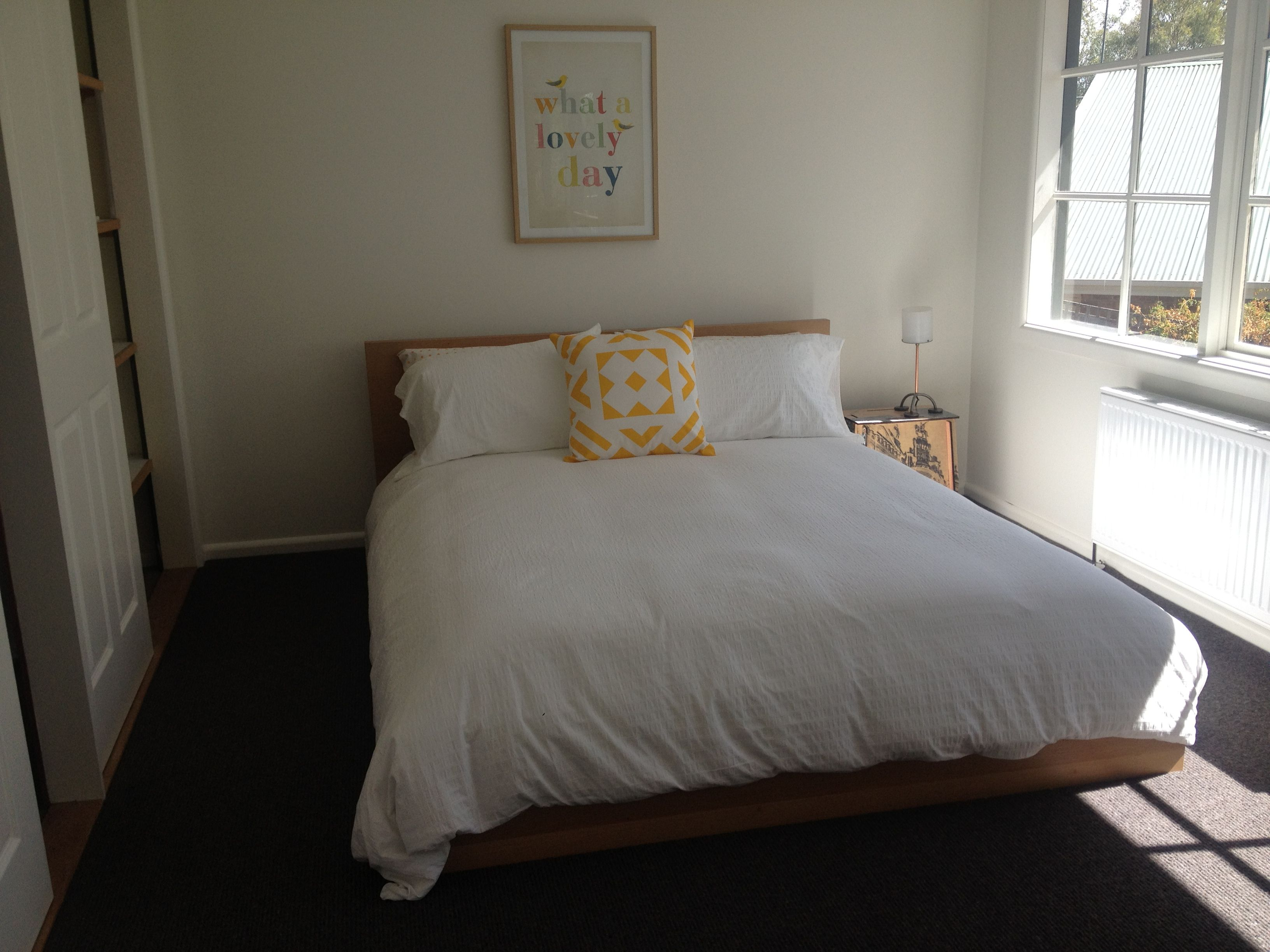 Charcoal dark grey carpet in bedroom with pop of colour yellow