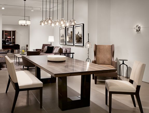 Contemporary dining room. Love the modern wood dining table, the chandelier lighting ...