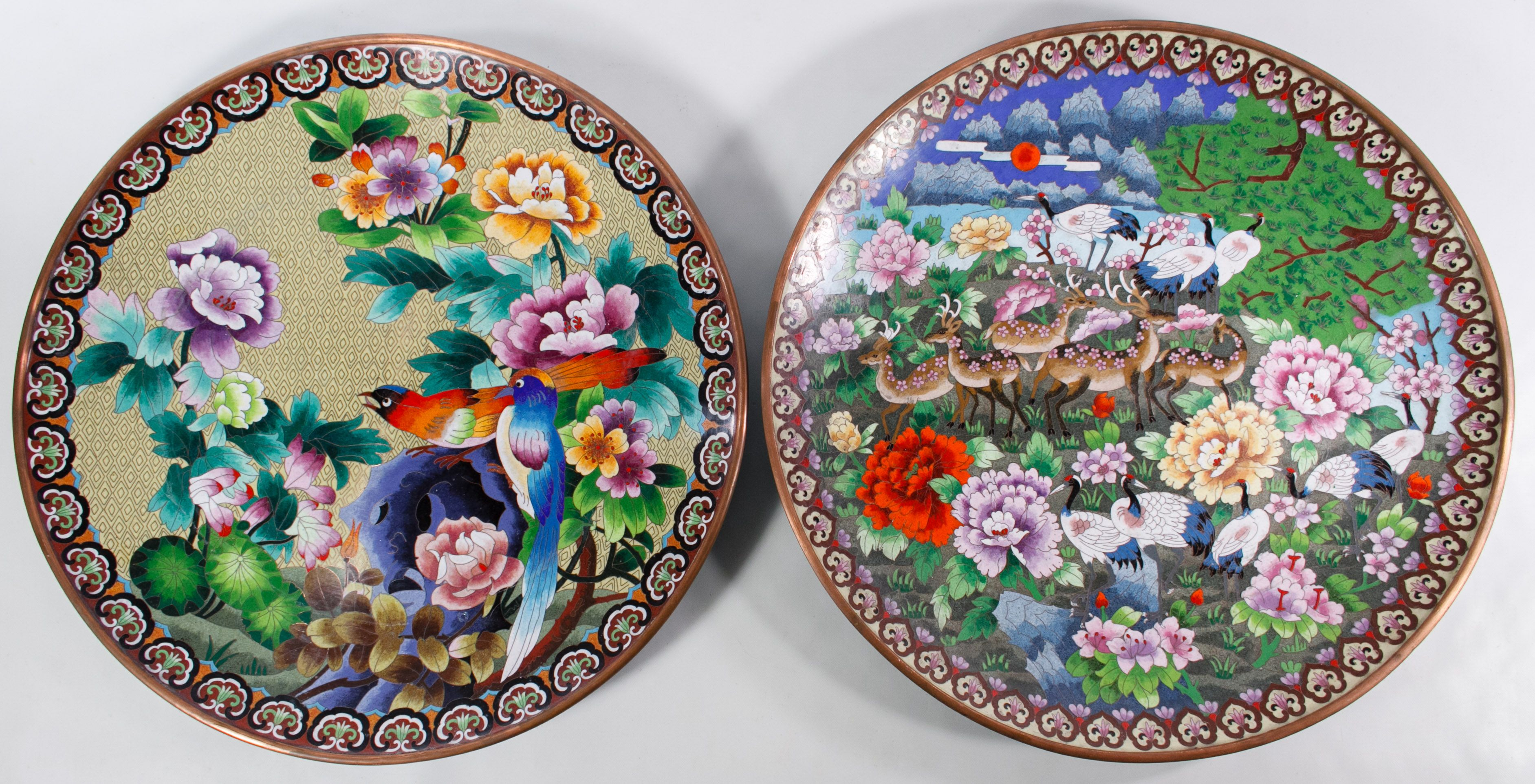 Lot 550: Asian Cloisonne Chargers; Two copper lined large round plates with animal, bird and floral decoration