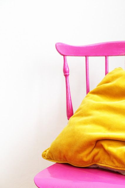 hot pink chair and yellow pillow