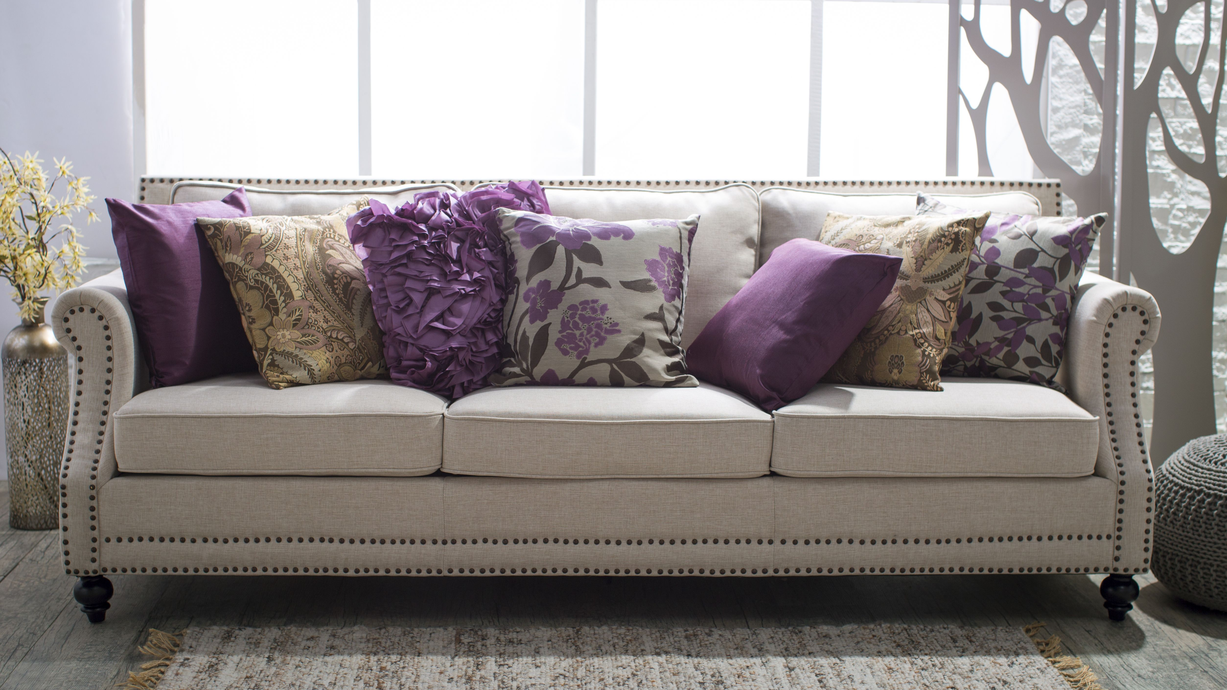 5 Ways To Decorate A Neutral Sofa With Throw Pillows Neutral Sofa Purple Sofa Purple Accent Pillows