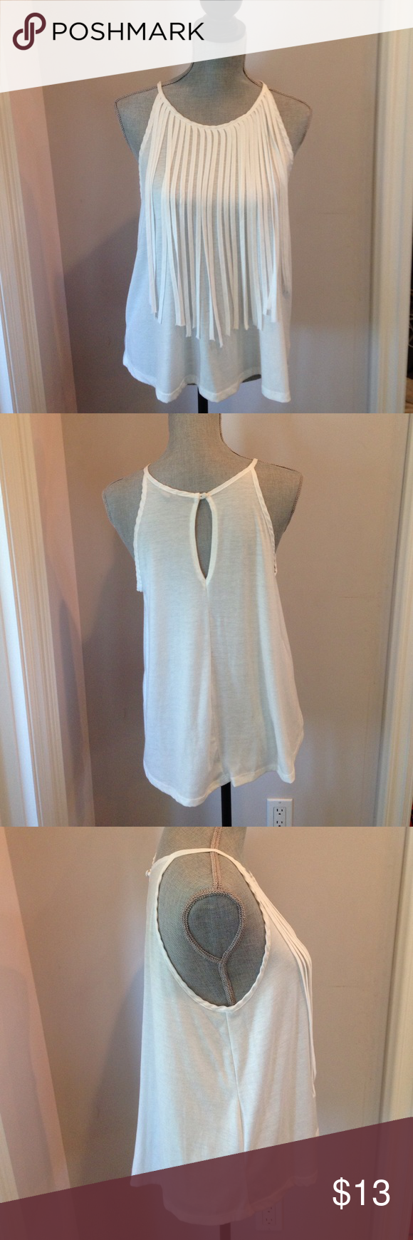 Flowy white fridge tank top This flowy tank top is perfect for any occasion. The tassels make the shirt playful. Never worn but without tags. 72% polyester 25% rayon and 3% spandex. Urban Outfitters Tops Tank Tops