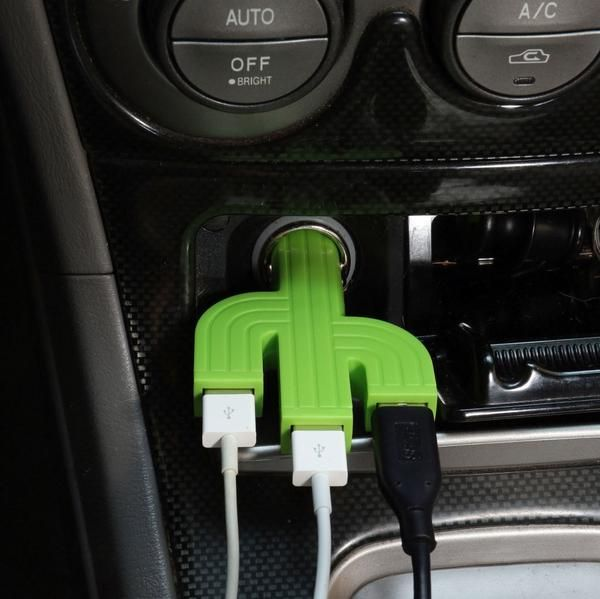 Kikkerland Design Cactus Car Charger. A prickly friend for your thirsty battery. Fits any lighter socket. 3.1 Amps allows for charging 3 mobile devices or 1 mobile and 1 tablet. 3 USB ports, compatible with most smartphones, tablets and USB chargeable devices. Input: 12 - 24 V. Output: 5V - 3.1A.;Size: Height 9cm x Length 6cm