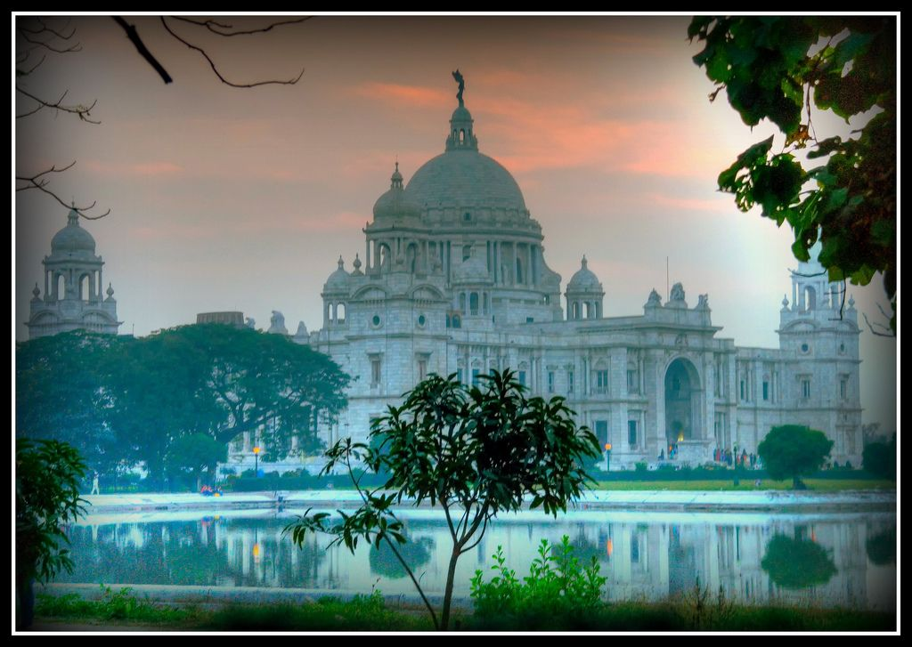 Victoria Memorialwas designed by Sir William Emerson similar to Belfast City Hall incorporating Mughal elements in the structure. Built 1906 - 1921, it is a majestic white marble building at the southern end of the Maidan and surrounded by a sprawling garden. A black bronze Angel of Victory, holding a bugle in her hand was placed at the apex of the dome above the Memorial. .