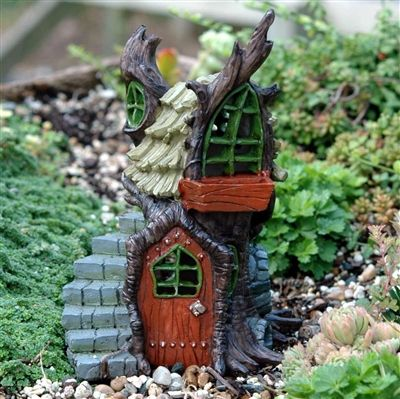 Fiddlehead Fairy Tree Stump Cottage with 9 cut-out windows.