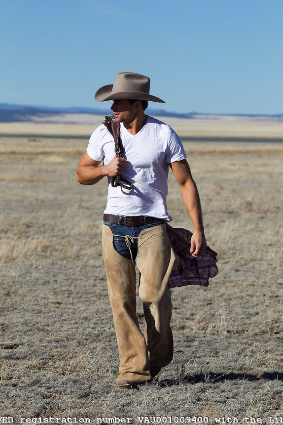 Hot cowboy walking on a ranch in New Mexico.Very nice wish i was there now. Please check out my website Thanks.  www.photopix.co.nz