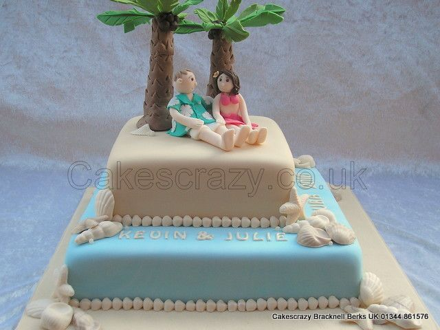 Cuban Beach Themed Two Tier Square Stacked Wedding Cake Covered In Ivory And Blue Icing Finished With Pearl Border Pearlecent Shells