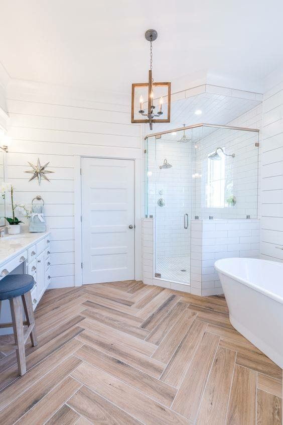 Porcelain tiles in herringbone | Bathroom design ...