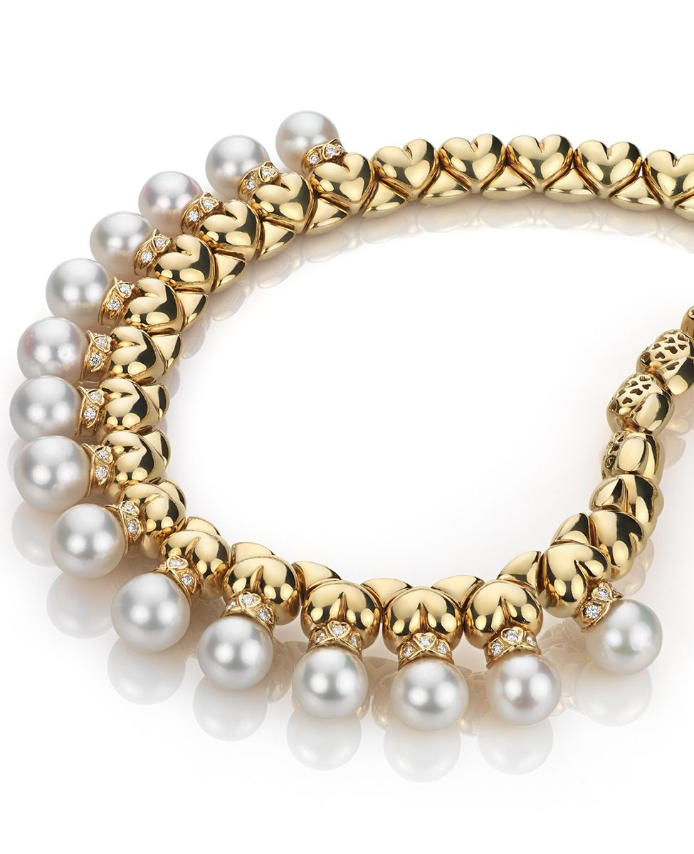 98de16563 Curated by Colin Cowie, this gorgeous Garrard necklace features 15 cultured  pearls suspended from 18k yellow gold heart links featuring 46 brilliant ...