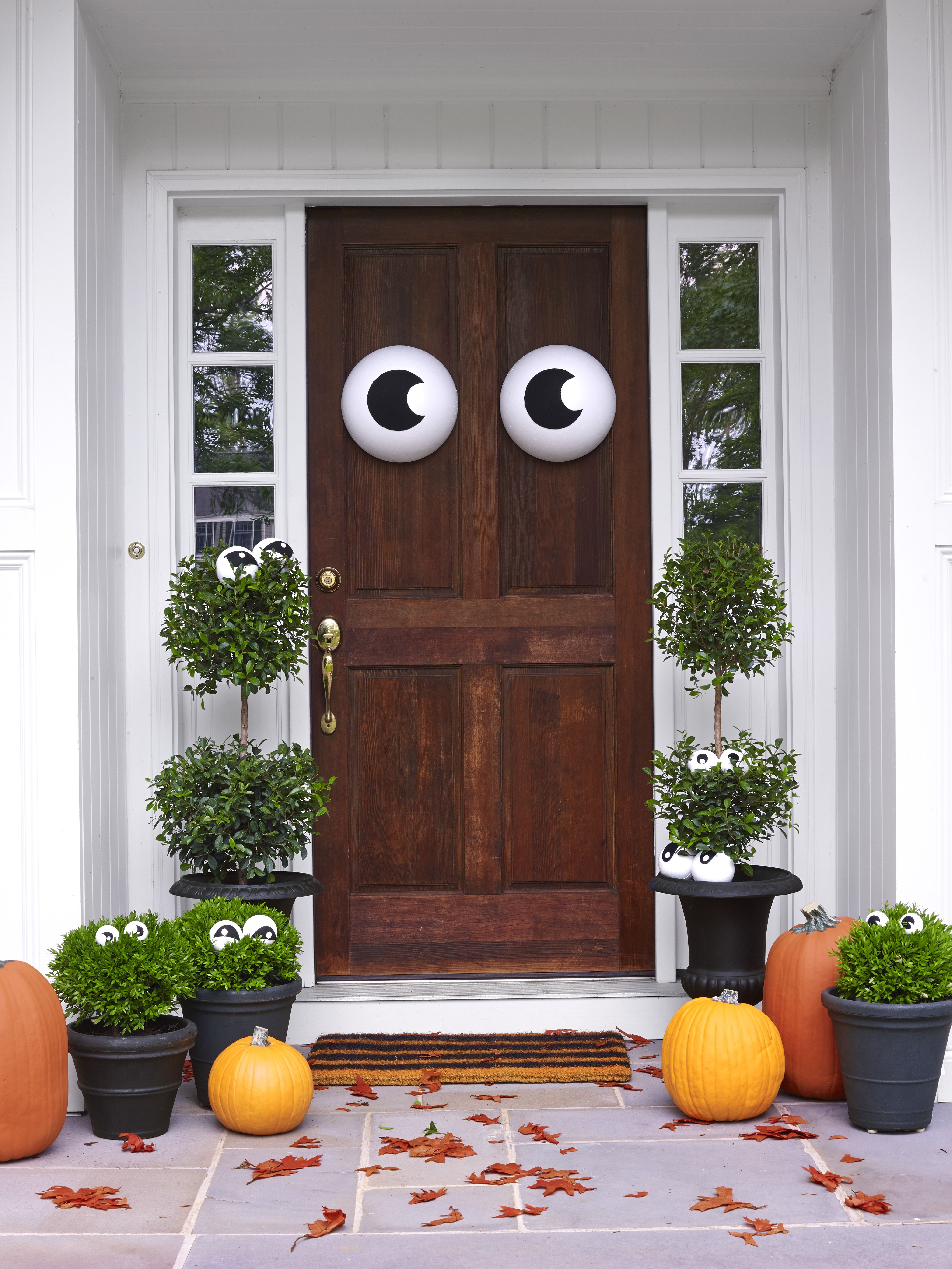 Your front door, potted plants and more will peer at passersby. Cut pupils out of adhesive-backed felt and position them on assorted Styrofoam balls or half-spheres (from $6.29 for 4; Amazon.com). Use double-stick tape to attach peepers to the door or skewers to stake them into greenery. - WomansDay.com