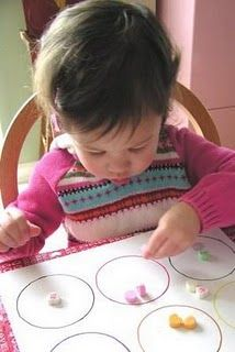 Another link full of fun Valentine's Day themed learning activities for your Bright Tot including this fun conversation heart math activity!
