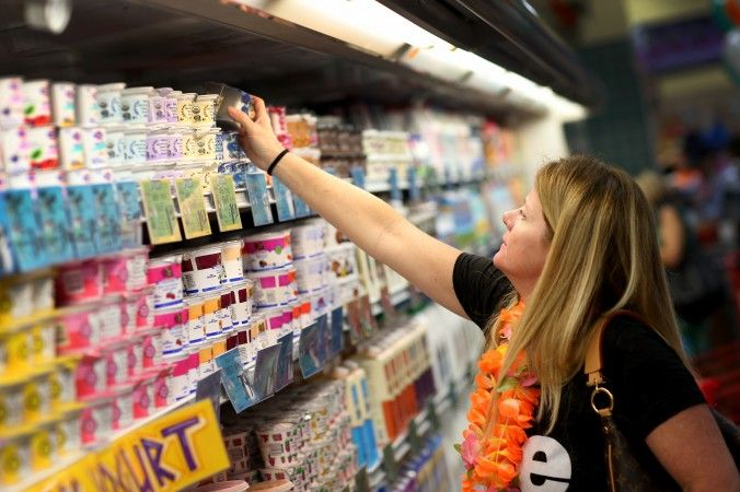 A customer shops for yogurt during the grand opening of a Trader Joe's on Oct. 18, 2013, in Pinecrest, Fla. (Joe Raedle/Getty Images)