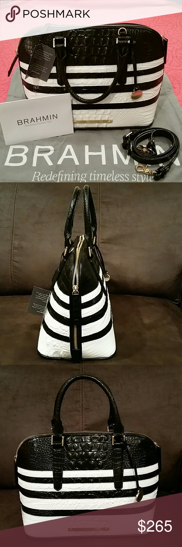 """NWT Brahmin Vivian Corsica Genuine Leather Satchel This black and white Vivian Dome Satchel is the ultimate in ladylike elegance. It's a spacious, structured satchel with a two way zipper. A versatile style, you may carry by hand or attach the longer strap to wear as a crossbody or over your shoulder. Double Handle Satchel. Removable, Adjustable Shoulder Strap. Double Zipper Closure. Footed Bottom. Interior Zip Pocket. Zip Jewelry Pocket. Two Organizer Pockets. 4.5"""" Handle Drop. 22.5"""" Strap…"""