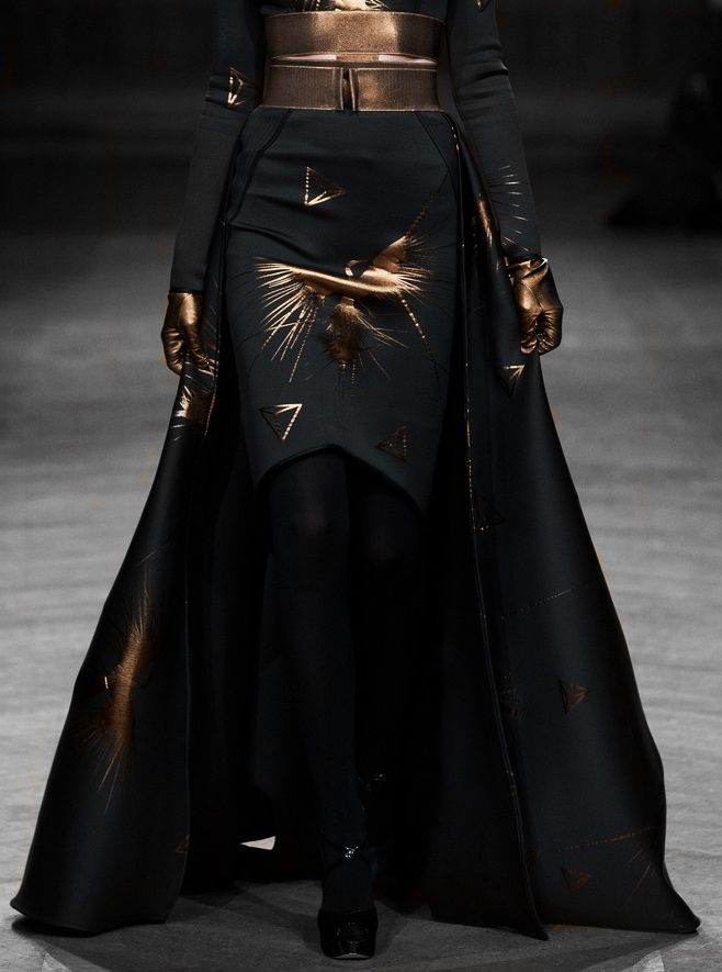 Oscar Carvallo 2013 bronze gloves, black tiered skirt with bronze bird print and bronze wide belt.