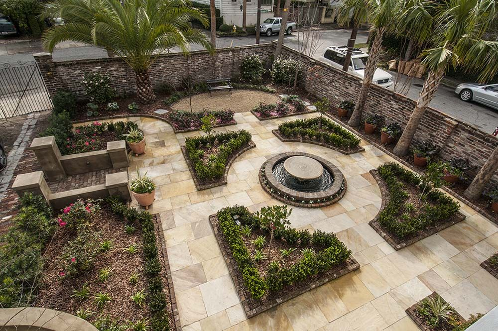 formal courtyard garden with boxwood parterre in downtown On formal courtyard gardens