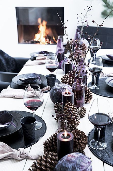 Beautiful Christmas table. The tabel is dressed in dark or neutral colors and with nature, for celebrations both simple and refined.