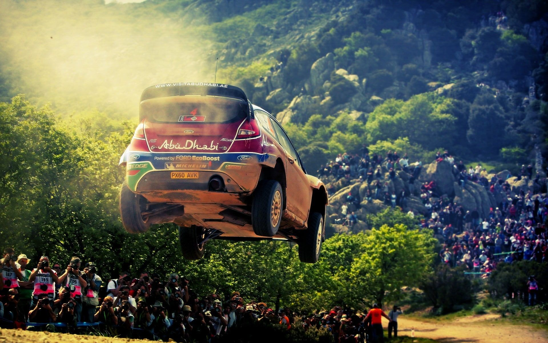 Ford Rally Cars Airborne Car Crowds Rally 1080p Wallpaper Hdwallpaper Desktop Rally Car Car Ford Car Wallpapers