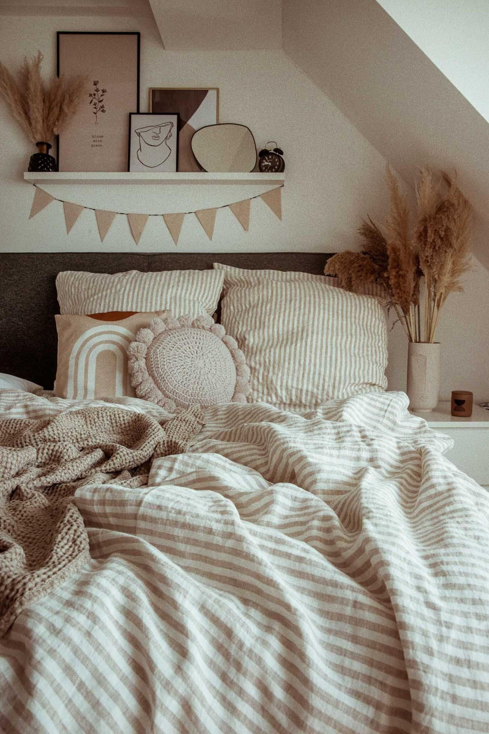 Give your bed an elegant makeover with stonewashed linen duvet set striped in off-white and natural linen (beige, oatmeal) colors. Made from softened linen fabric, this bed sheet set will add coziness to your bedroom and guarantee a good night's sleep.