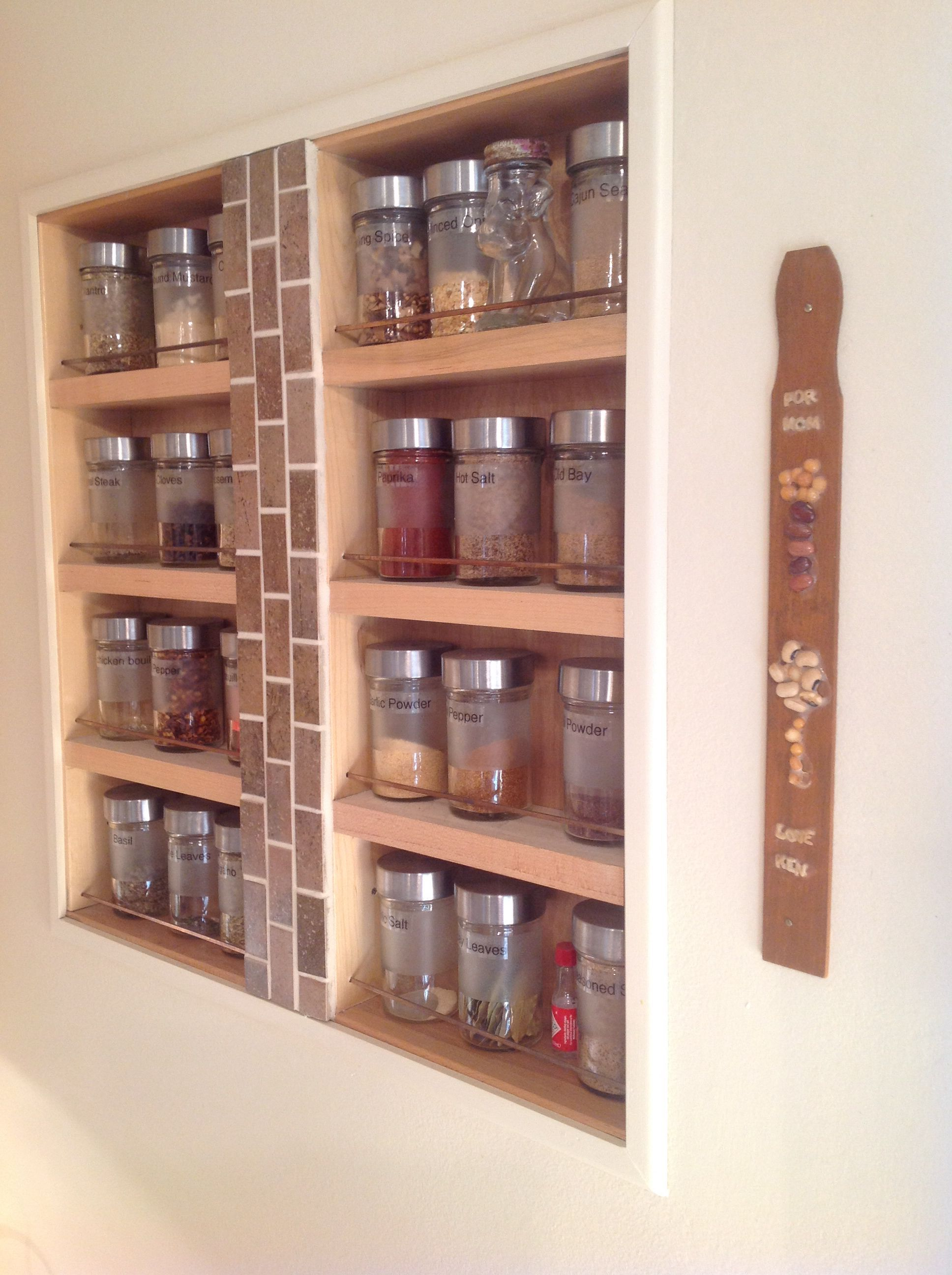 Spice rack made from kitchen drawers Inset between studs and framed