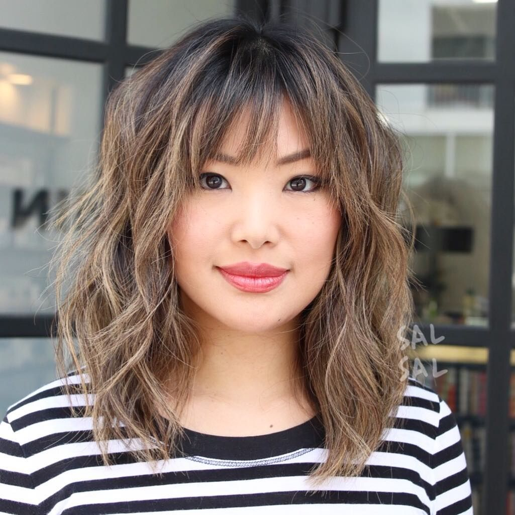 18+ Hairstyles for medium wavy hair with bangs ideas in 2021