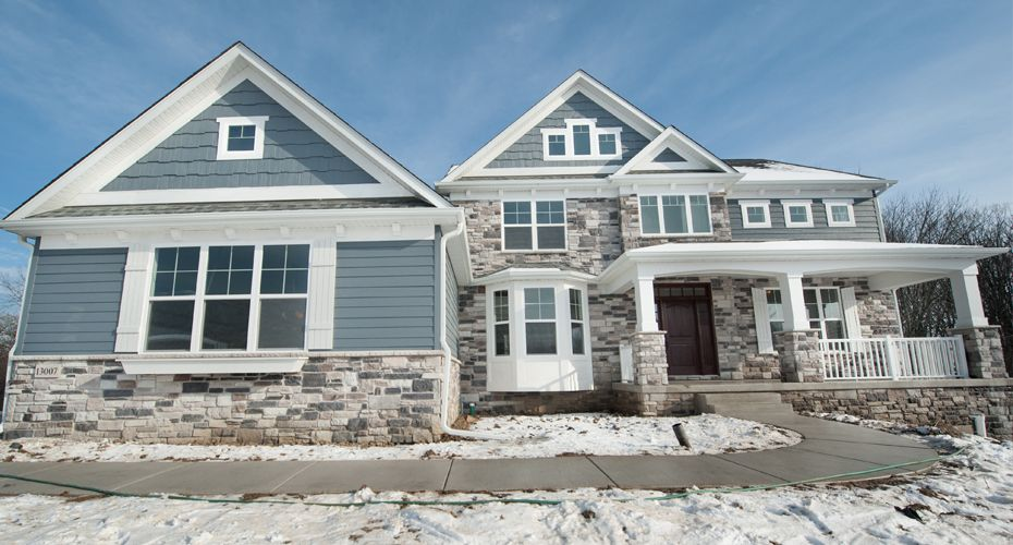 With new england front elevation including stone bay for Large front windows house