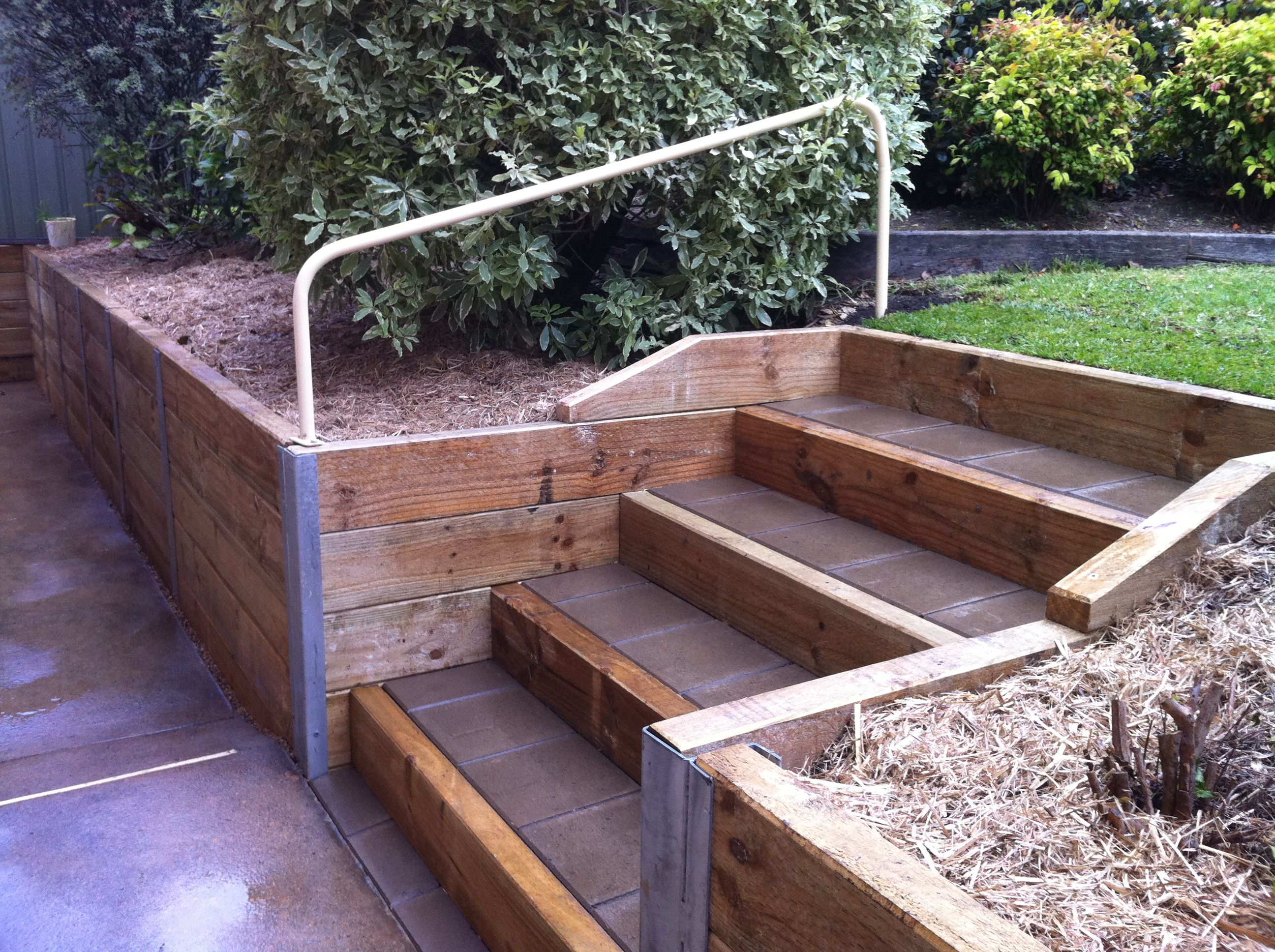 wood retaining walls with stairs beam timber retaining wall and paved stairs - Timber Retaining Wall Design