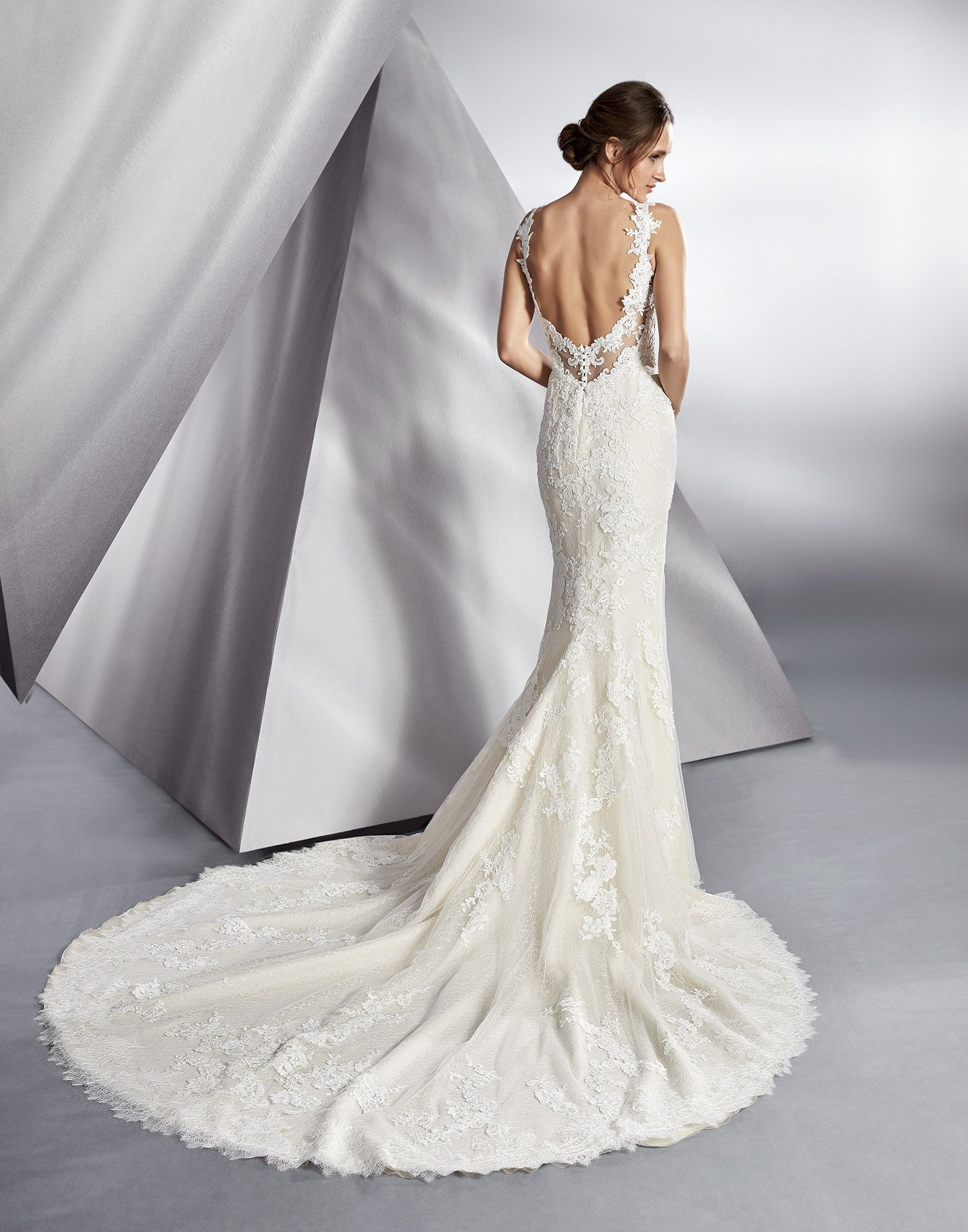 Beautiful a full and luxurious sleek lace wedding dress with an