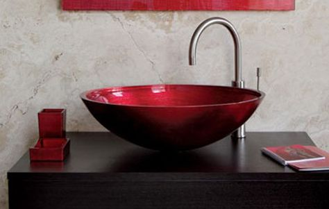 Against the rich brown, the Red Venetian Glass Vessel Sink looks like a  cherry tucked