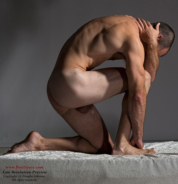 Nude male art model poses