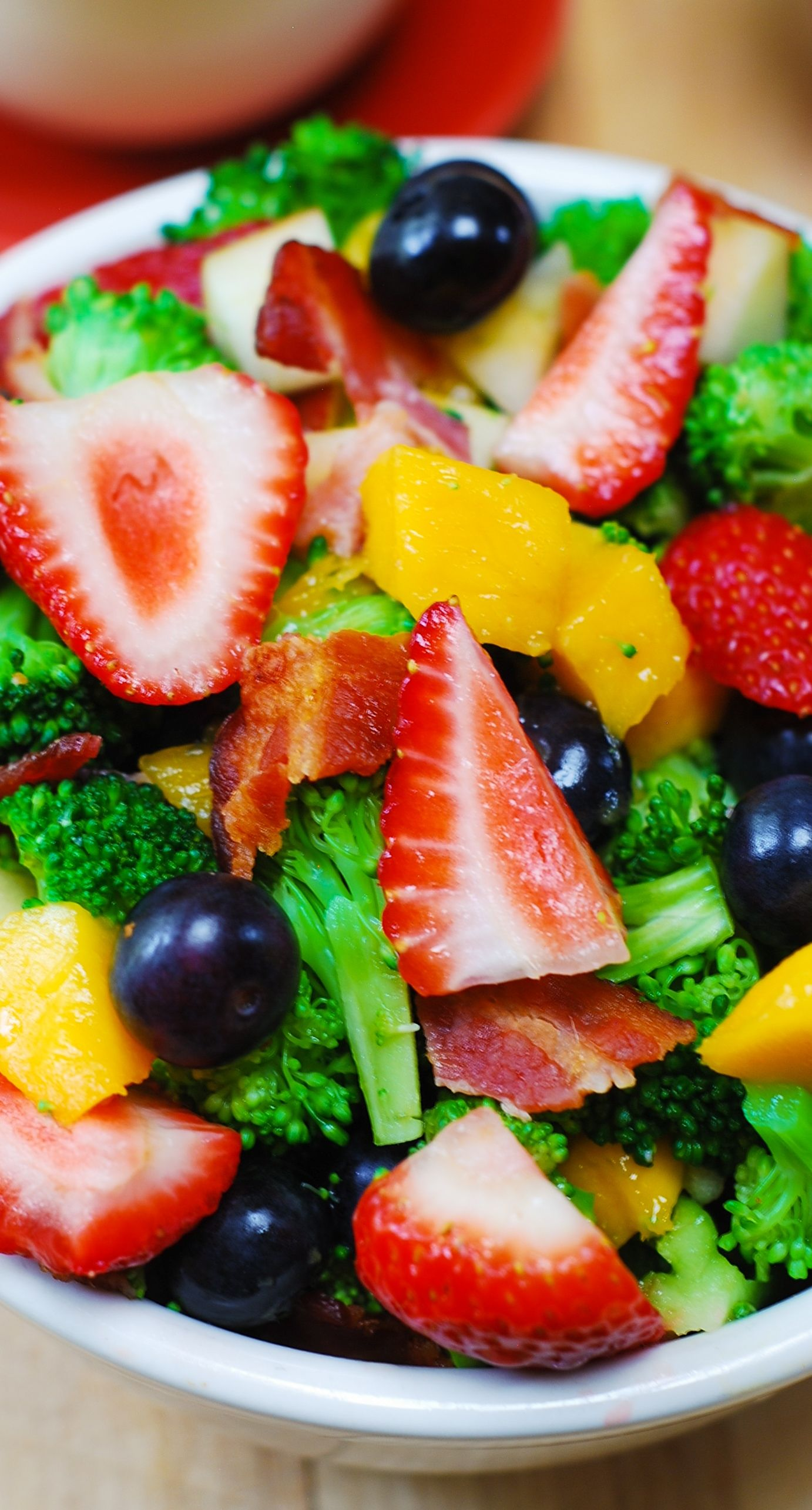 Broccoli salad with strawberries, blueberries, mango, apples, and bacon, with creamy homemade salad dressing! #gluten_free #summer_salads #healthy_ingredients