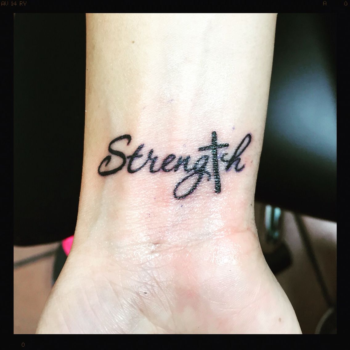 strength tattoo with cross favs
