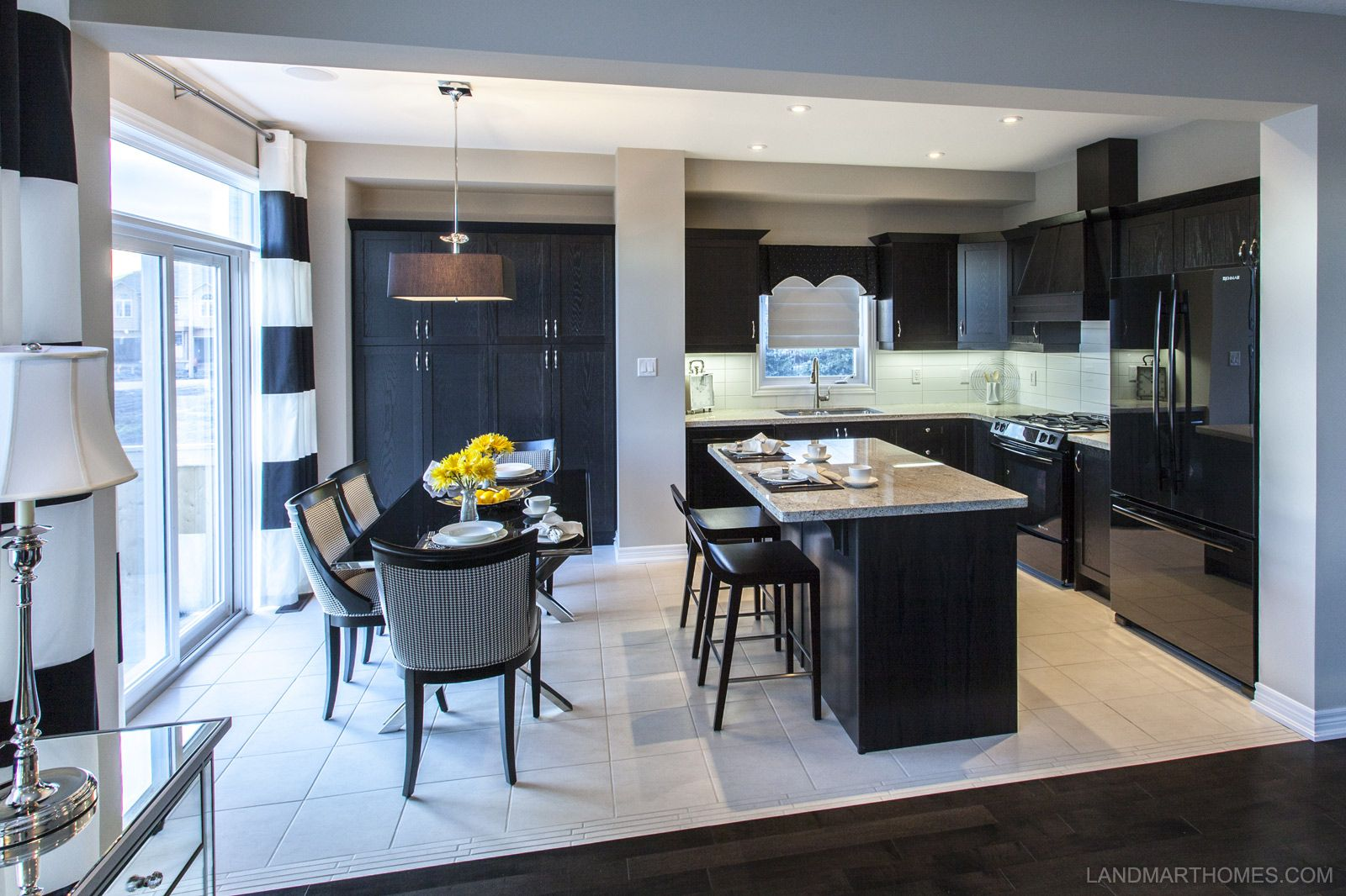 A kitchen with a modern style from Penny Lane Estates by Landmart Homes in  Stoney Creek